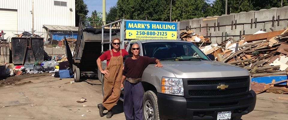 Mark's Hauling & Recycling staff posing by truck